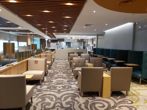 A restaurant or other place to eat at Ambassador Transit Lounge Terminal 3