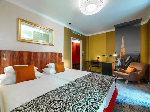 Een bed of bedden in een kamer bij Hotel Capricorno
