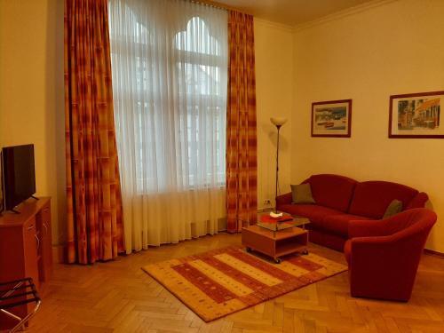 Ein Sitzbereich in der Unterkunft Altwernigeröder Apparthotel