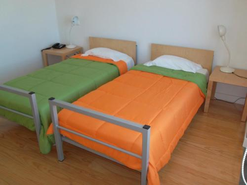 A bed or beds in a room at Azores Youth Hostels - Santa Maria