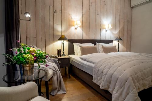 A bed or beds in a room at Frost Boutique Hotel