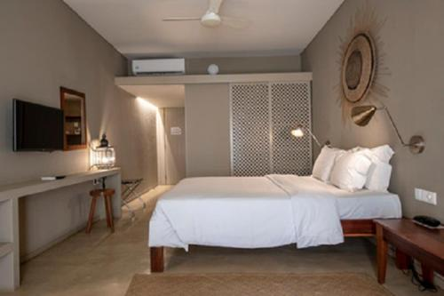 A bed or beds in a room at Kirimizi Hotel & Restaurante