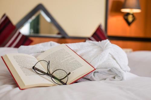 A bed or beds in a room at Landhotel Eibl