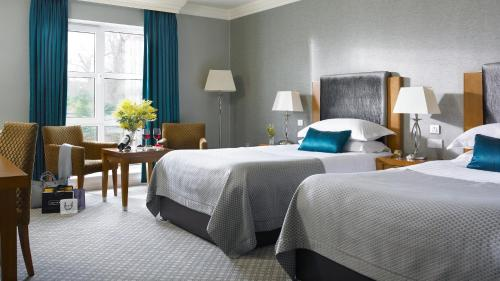 A bed or beds in a room at The Killarney Park