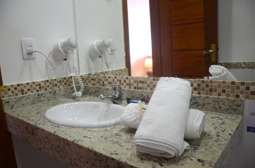 A bathroom at Ilha Branca Exclusive Hotel