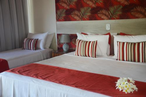 A bed or beds in a room at Ilha Branca Exclusive Hotel