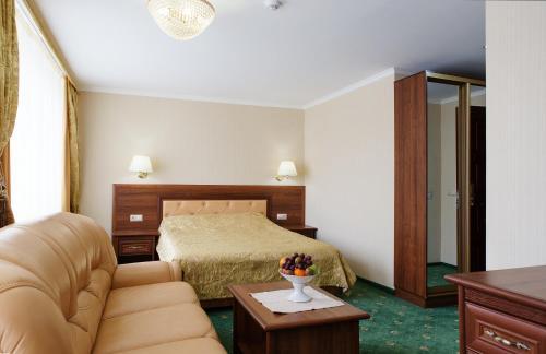 """Кровать или кровати в номере Гостиничный комплекс """"Ставрополь"""", Hotel Stavropol"""