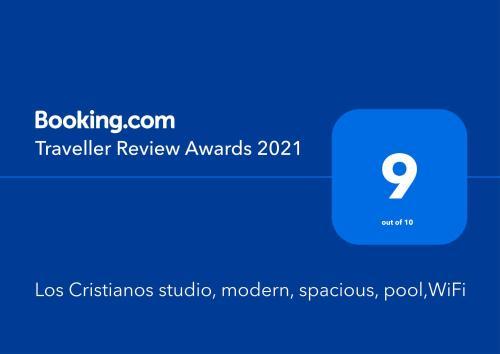 Certificado, premio, señal o documento que está expuesto en Los Cristianos studio, modern, spacious, pool,WiFi