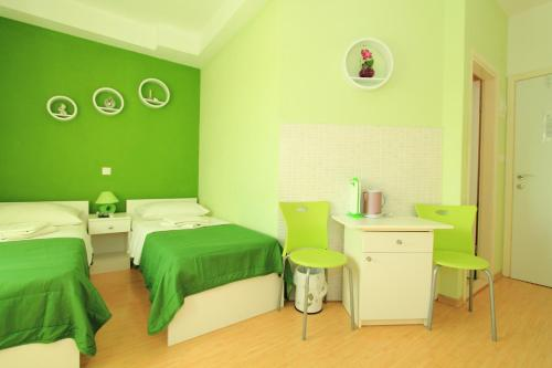 A bed or beds in a room at Nirvana Rooms & Apartments