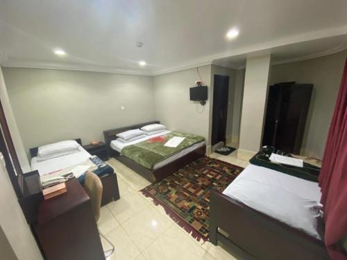 Cama ou camas em um quarto em فندق النهضة Al Nahda Hotel