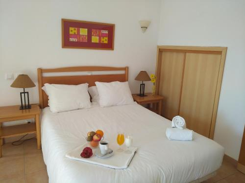 A bed or beds in a room at Club House CVL