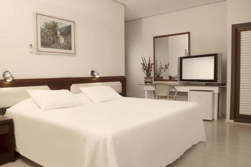 A bed or beds in a room at CHA Prime Curitiba