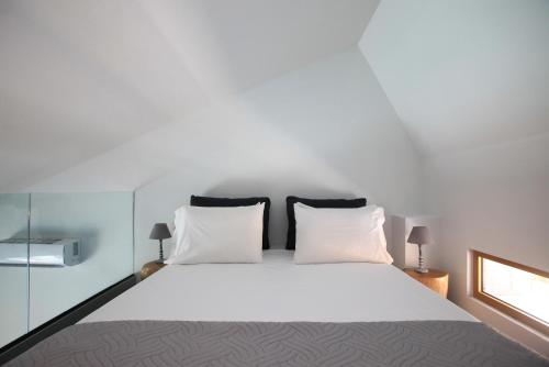 A bed or beds in a room at Meropi Hotel & Apartments