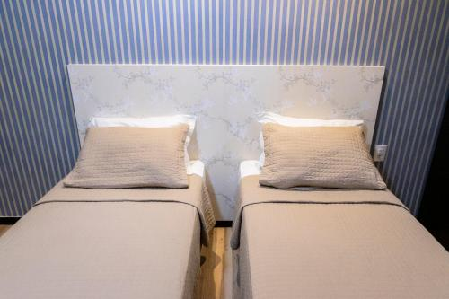A bed or beds in a room at Hotel Executive Flat Arrey