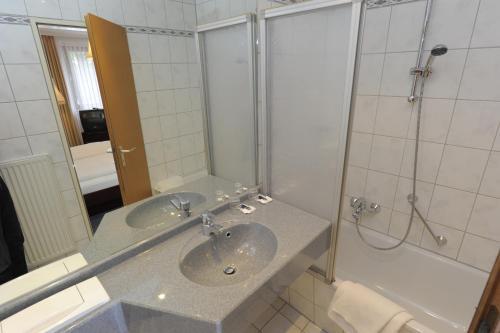 Ванная комната в Hotel Heldt Dependance