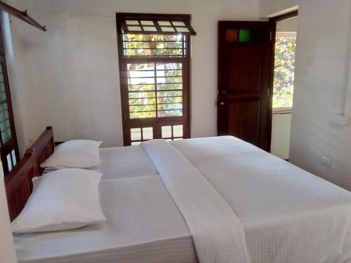 A bed or beds in a room at ADRI CHEMBRA