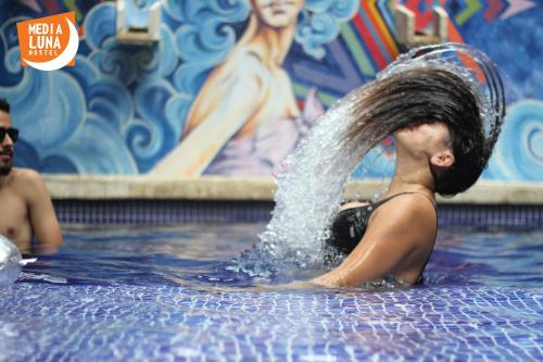 The swimming pool at or near Media Luna Hostel Cartagena