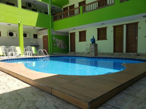 The swimming pool at or near Pousada Ouriço