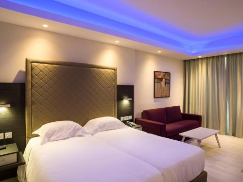 Een bed of bedden in een kamer bij Frangiorgio Hotel