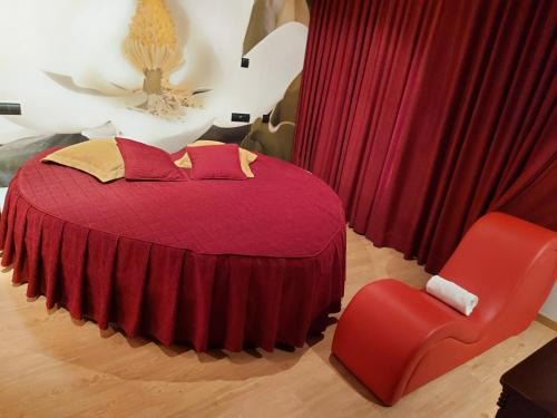 A bed or beds in a room at Motel Acropolis
