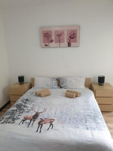A bed or beds in a room at Royal Bansko Aparthotel 206D