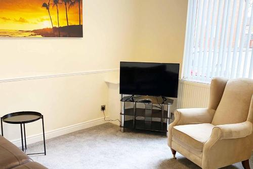 A television and/or entertainment center at Briscoe Serviced Accommodation