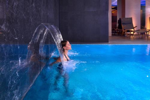 The swimming pool at or close to Time Boutique Hotel