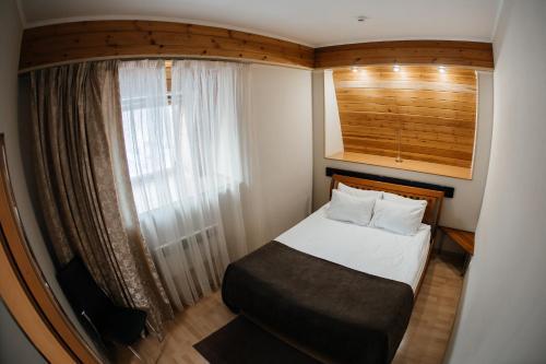 Кровать или кровати в номере Клубный Отель Прионежский
