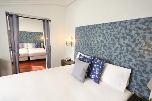Cama o camas de una habitación en Hotel Conde Rodrigo 2