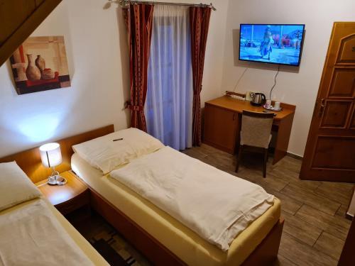 Posteľ alebo postele v izbe v ubytovaní Ferdinand Penzion