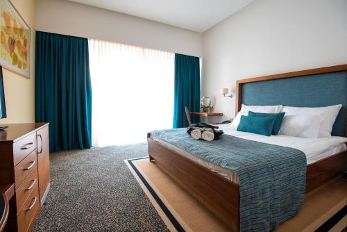 Кровать или кровати в номере Hotel Vitarium Superior - Terme Krka