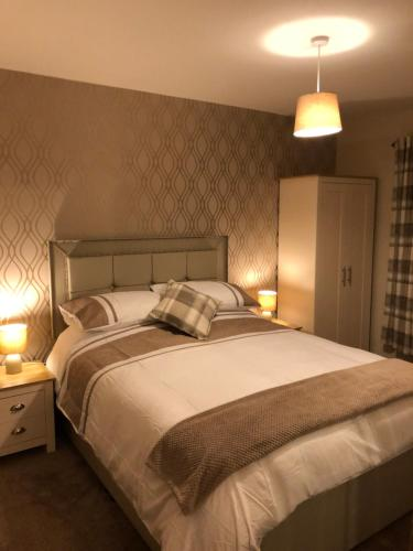 A bed or beds in a room at Bruxie Holiday Cottages