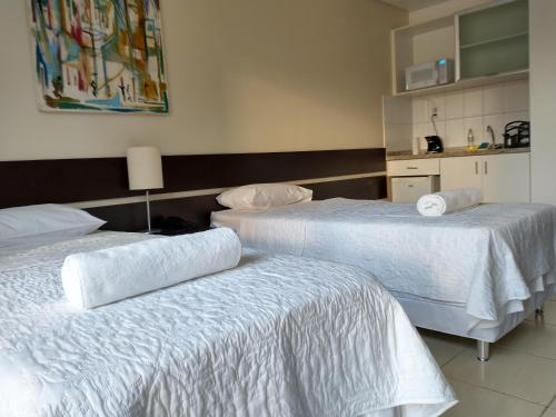 A bed or beds in a room at América Towers 611