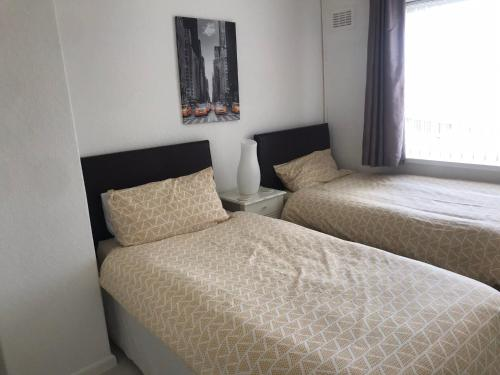 A bed or beds in a room at Diana House - Great location