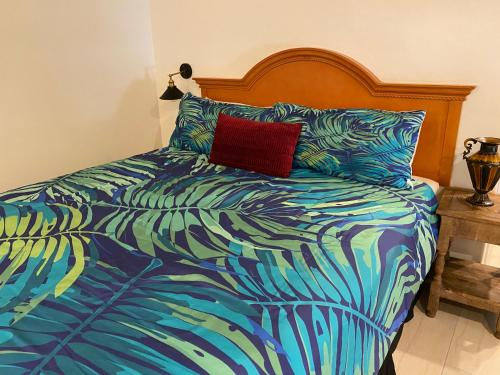 A bed or beds in a room at Villa Rosa Inn