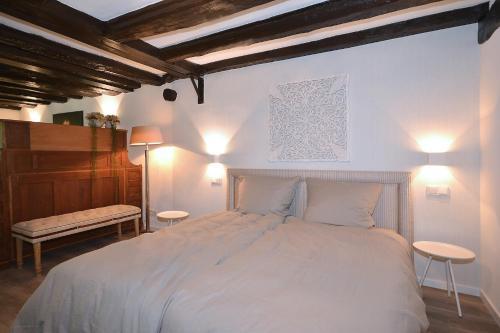 A bed or beds in a room at Villa Delange