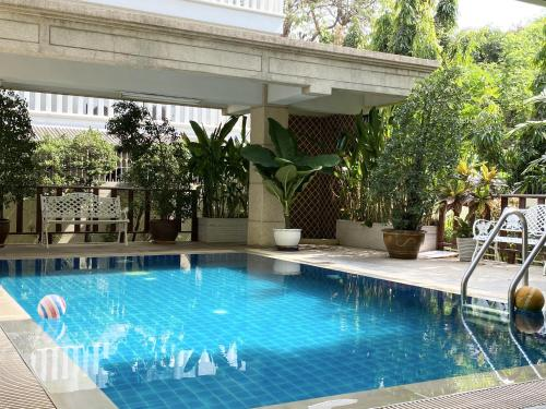 The swimming pool at or near 14 Place Sukhumvit Suites