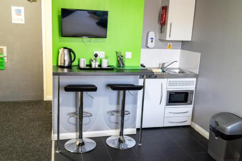 A kitchen or kitchenette at Lymedale Suites Studios & Aparthotel in NEWCASTLE UNDER LYME & STOKE