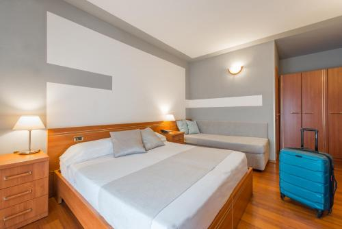 A bed or beds in a room at Loano 2 Village