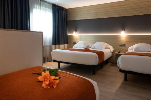 Cama o camas de una habitación en Hotel Avenida