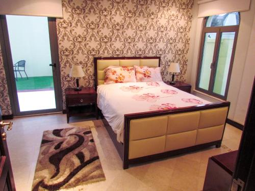 A bed or beds in a room at Deluxe Villa B Fond with Private Pool and Beach