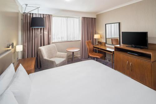 A television and/or entertainment center at Crowne Plaza Glasgow, an IHG Hotel