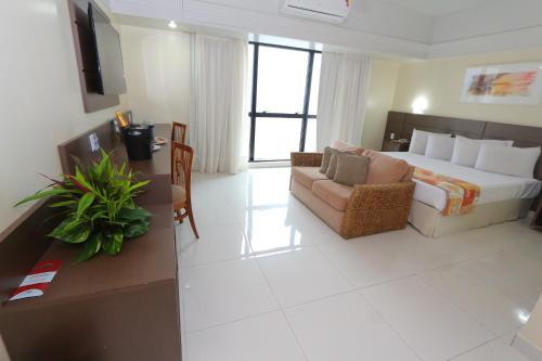 Zona de estar de Tropical Executive Hotel