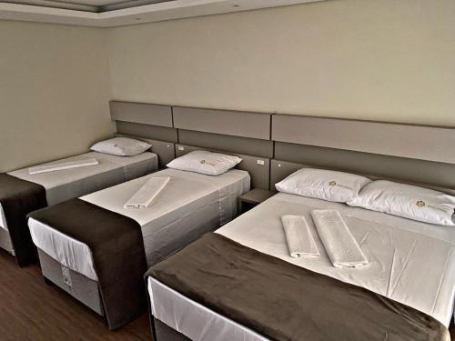 Cama ou camas em um quarto em Hotel Joaçaba