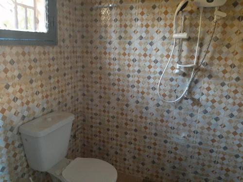Salle de bains dans l'établissement Villa Chambre A climatisée douche Cuisine salon