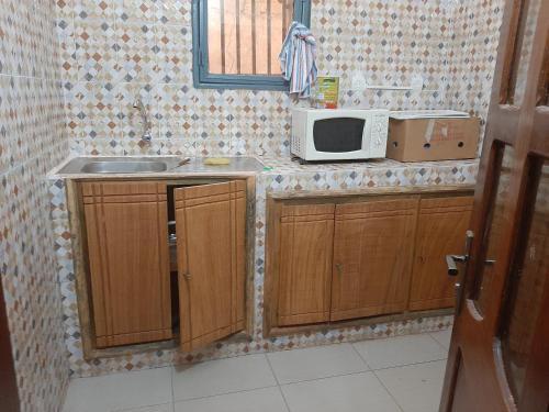 Cuisine ou kitchenette dans l'établissement Villa Chambre A climatisée douche Cuisine salon