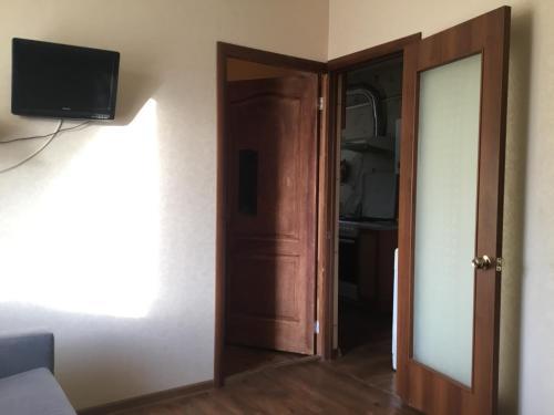 Телевизор и/или развлекательный центр в Apartment Nagibina