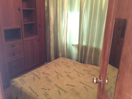 Кровать или кровати в номере Apartment Nagibina