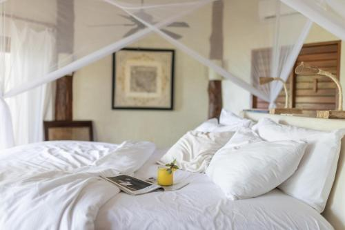 A bed or beds in a room at Encantada Tulum