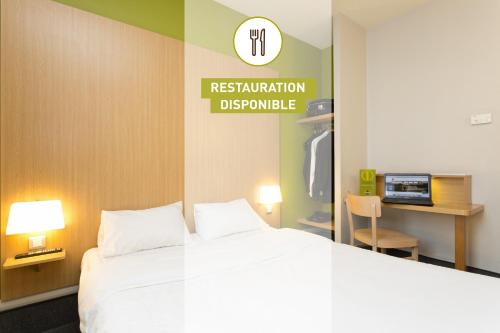 A bed or beds in a room at B&B Hôtel Grenoble Centre Verlaine